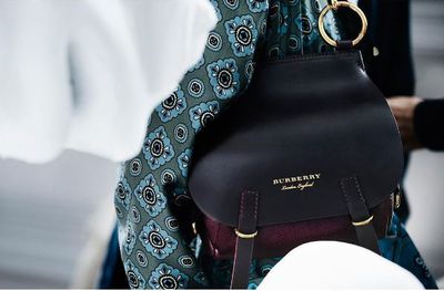 Made exclusively for DFS this bridle bag in burgundy and black perfectly captures Burberry's dna.