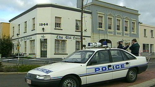 A police car outside the crime scene at a hairdressing salon in 1991. (9NEWS)