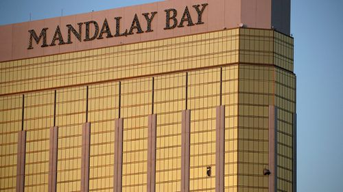 Drapes billow out of broken windows at the Mandalay Bay resort and casino  (Image: AP/John Locher)