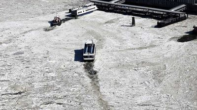 A ferry navigates through the loose ice to port.