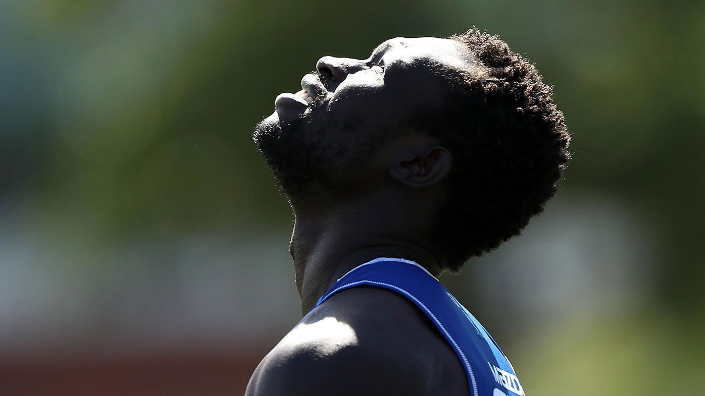 Majak Daw cheered on by North Melbourne teammates in return to training track