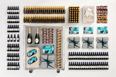 Qantas bar cart for sale featuring Qantas PJs, wine, champagne, Tim Tams