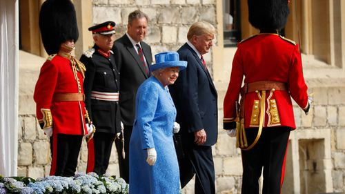 Carrying a handbag between herself and Mr Trump, the pair did not appear to engage in conversation during the formal ceremony. Picture: AP