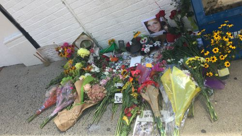 Men, women and children have paid tribute to Heather Heyer and others injured when a car ploughed into the crowd. (Lizzie Pearl)