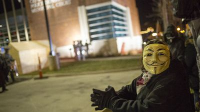 Protesters demonstrate in front of the Ferguson police station as the riots enter a second night. (Getty Images)