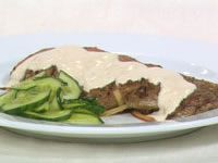 Garlic lamb fillets with tahini sauce