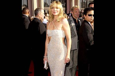 <b>Where she wore it:</b> The 55th Annual Primetime Emmy Awards, 2003.<br/><br/><b>The look:</b> Not that Sarah Jessica is the only <i>Sex and the City</i> Emmys fashion offender. Kim's gown looks like it has bits missing.