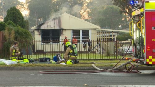 A man in a wheelchair was whisked to safety from his home this morning as a fire broke out in the property. Picture: 9NEWS.