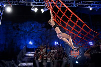 Super mum Maggie-Laurie Spark makes it onto the Cargo Net.