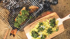 Rice pilaf with flaked whole barbecued barramundi