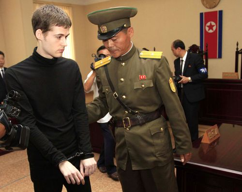 Handcuffed, American Matthew Miller leaves after his trial at the Supreme Court in Pyongyang, North Korea. (AAP)