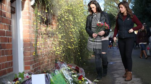 Fans leave floral tributes outside George Michael's London home. (AAP)
