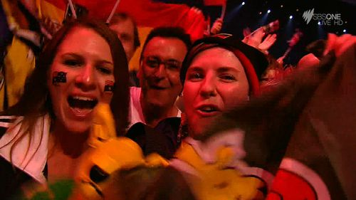 Australian fans cheer Sebastian's performance. (SBS)