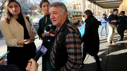 Victim Enver Shabanay speaks to the media outside the District Court in Adelaide. Financial adviser James David Gibbs has been jailed for at least seven years after systematically stealing the life savings of his clients.