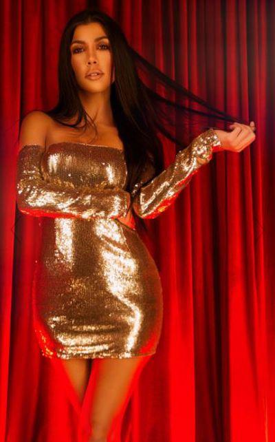 "<a href=""https://www.prettylittlething.com.au/gold-sequin-long-sleeve-bardot-bodycon-dress.html"" target=""_blank"">Gold sequin long sleeve bardot bodycon dress, $90.</a>"