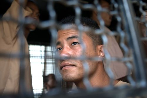 Myanmar national Zaw Lin arrives in a prison transport van outside Koh Samui court in Thailand on July 9, 2015. Lin had been found guilty and sentenced to death.