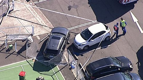 Police are investigating after a car ploughed into two pedestrians south of Sydney today. Image: 9NEWS