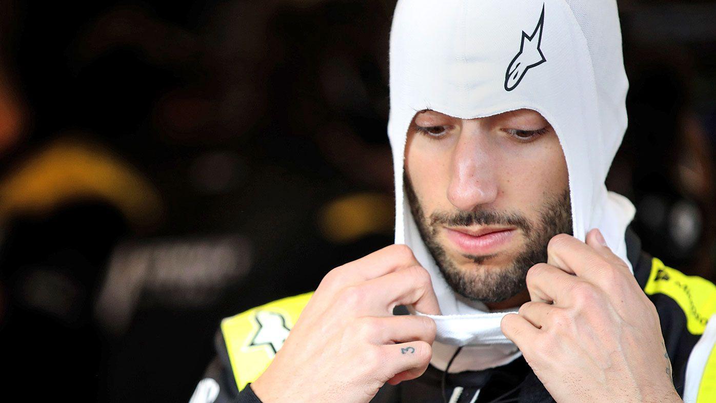 Daniel Ricciardo of Australia and Renault Sport F1 prepares to drive in the garage