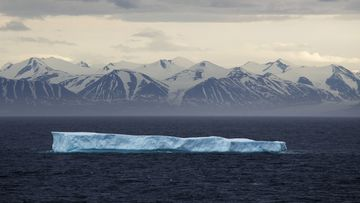 In this July 24, 2017, file photo, an iceberg floats past Bylot Island in the Canadian Arctic Archipelago.