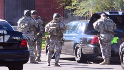 <p>Local authorities believe up to three suspects entered the building before they opened fire. Fourteen people have been confirmed dead, a further 17 were injured. (Doug Saunders/AAP)</p>