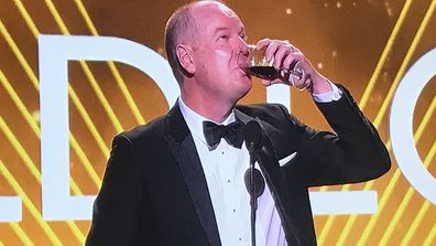 Tom Gleeson drinks wine while delivering his Gold Logie acceptance speech