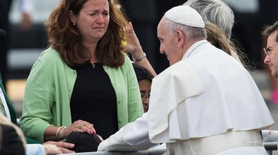 """Nearing the end of his trip, the Pope kissed the forehead of a 10-year-old boy with cerebral palsy after spotting him in the crowd at a Philadelphia airport.<br><br> Pope Francis reportedly saw the boy, Michael Keating, as he was being driven away from his plane and ordered his driver to stop.<br><br>Francis got out and walked over to the boy, put his hand on his head and kissed him as his sobbing mother looked on.<br><br> """"It was an unbelievable feeling,"""" his mother Kristin Keating told CBS News, adding she felt """"totally blessed and loved"""" by the pope."""