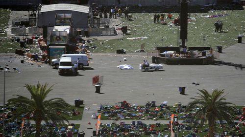 Debris is strewn across the site of the music festival. (AP)