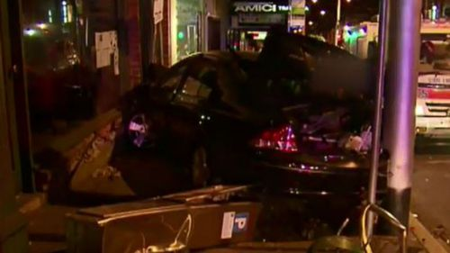 Driver mounts kerb and crashes into shops in Melbourne's east