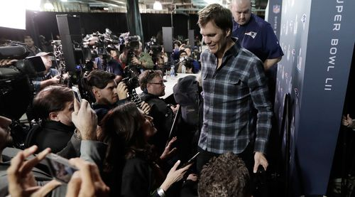 Tom Brady, 40, is swarmed by the media in the lead up to Monday's game. (AAP)