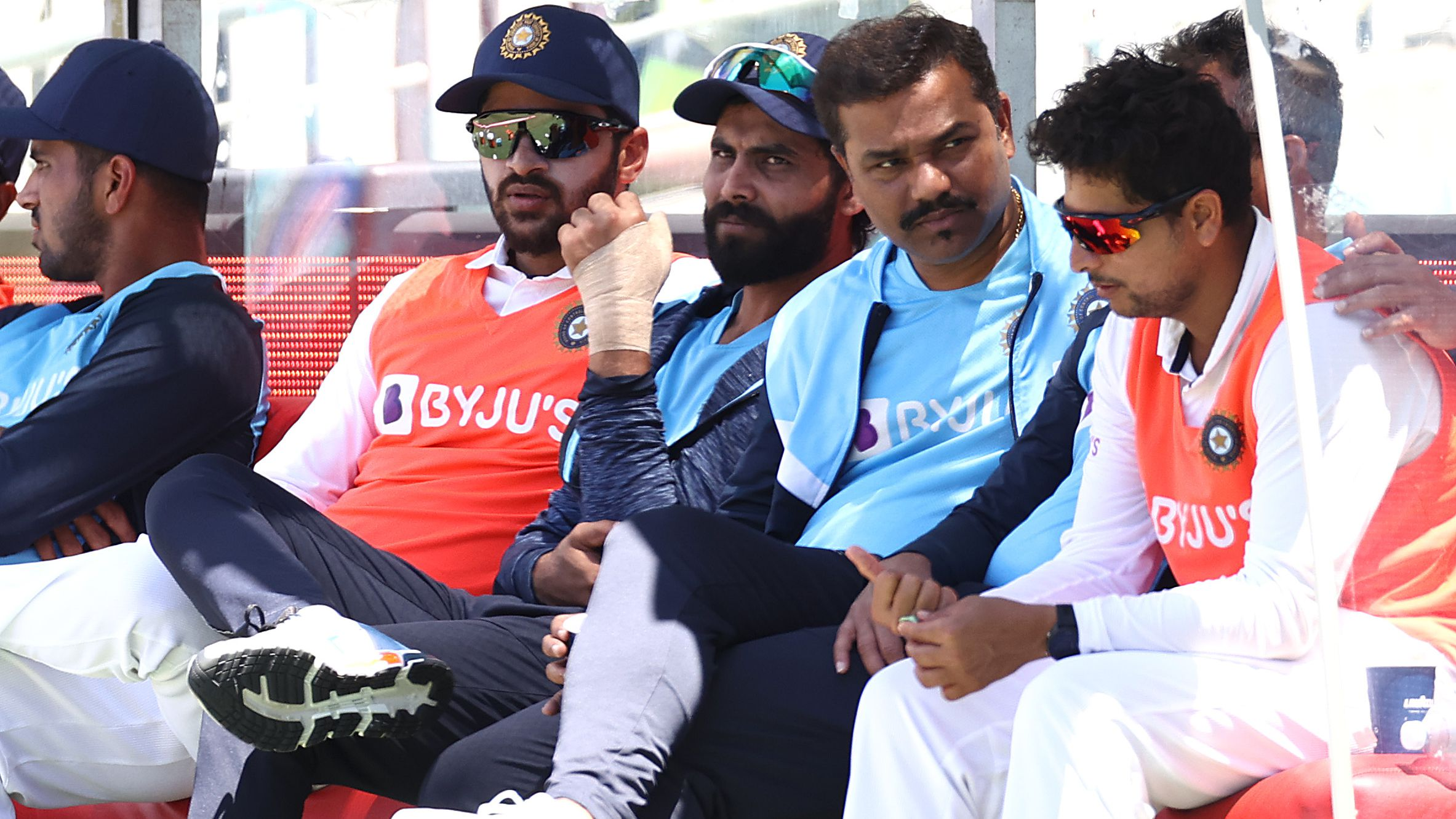 Ravindra Jadeja of India looks on after inuring his hand during day four.
