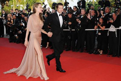 The following year a slim Angelina accompanied her man down the red carpet in sexy nude Versace. Wowser!