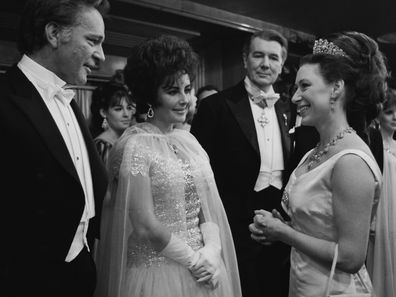 Princess Margaret chatting to Richard Burton and his wife Elizabeth Taylor at the Royal Film Performance of 'The Taming Of The Shrew' in 1967.