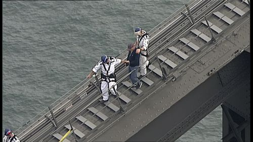 Police negotiators escorted the man from the southern arch of the Sydney Harbour Bridge. (9NEWS)
