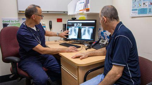 Professor Dan Chambers in consult with patient Tony Constantine.