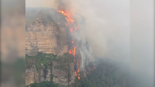'Mega fire' filmed climbing up cliff over 200 metres high
