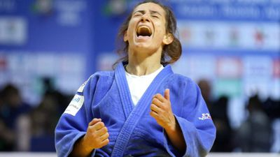 Competing as an independent country for the first time, Majlinda Kelmendi of Kosovo pulled off her country's first ever gold medal win. (AAP)
