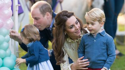 <p>Kate shares a sweet moment with George at a children's party for military families, 2016</p>