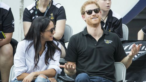 The pair were watching the Australia and New Zealand wheelchair tennis final.