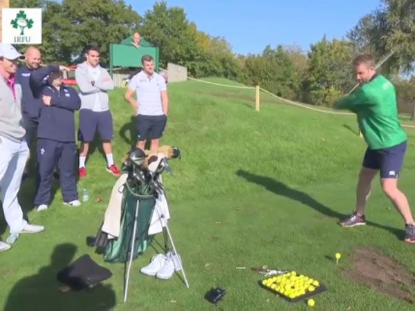 Ireland rugby star Luke Fitzgerald tries to tee off as Rory McIlroy and his teammates watch on. (Supplied)