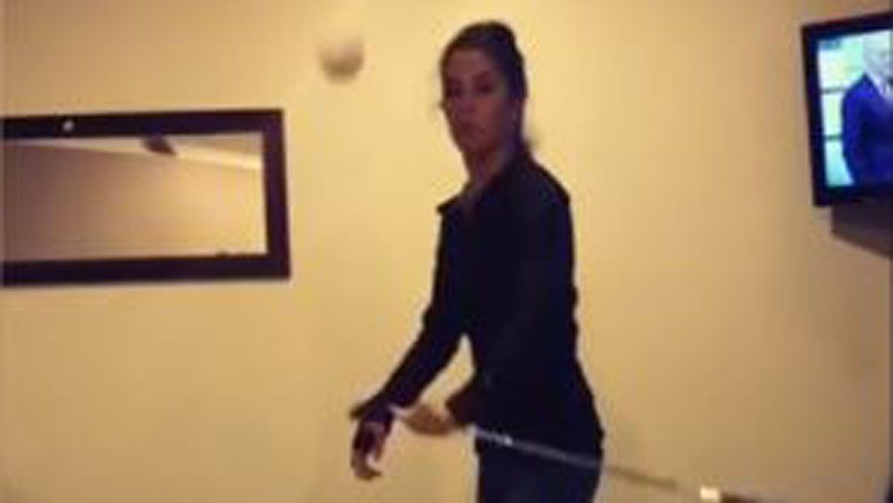 Golf pro Tania Tare mixes trick shots with beer pong