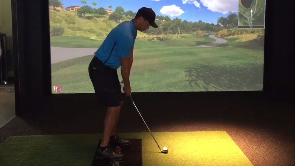 Woods posts video to scotch rumours