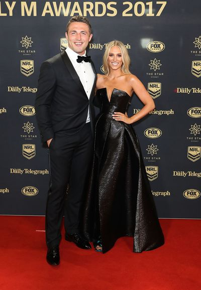Sam Burgess of the Rabbitohs and wife Phoebe in Alex Perry