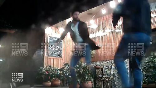 A security captured some of the alleged fight outside the eatery in Forster.