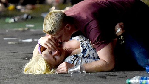 A concertgoer is comforted by a friend after being hit.