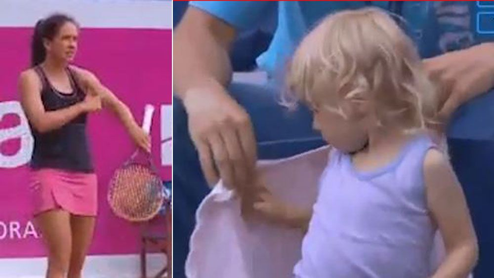Swiss tennis player Patty Schnyder stops mid-match to make sure he daughter is taken care of