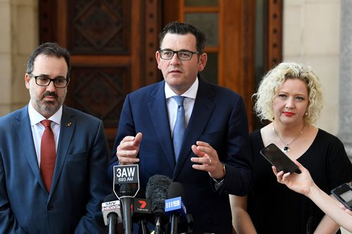 Victorian Premier Daniel Andrews is joined by Minister for Health Jill Hennessy (right), and State Attorney-General Martin Pakula (left) outside Parliament House for a press conference after an assisted dying vote today. (AAP)