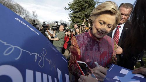 Hillary Clinton signs autographs after voting in Chappaqua, New York. (AAP)