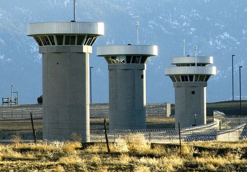 Guard towers loom over the prison.