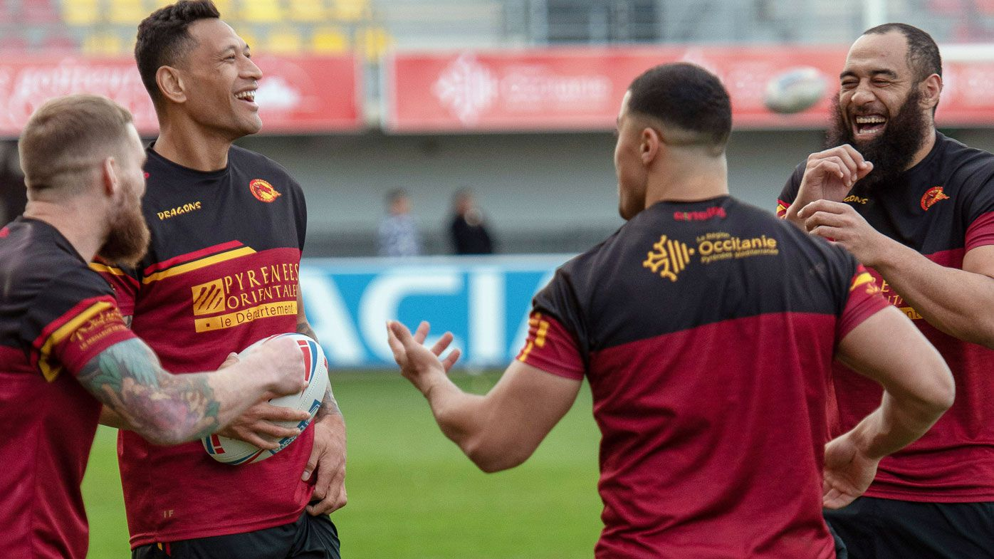 Australia's Israel Folau, second from left, smiles with teammates during a training session with his new club Catalan Dragon