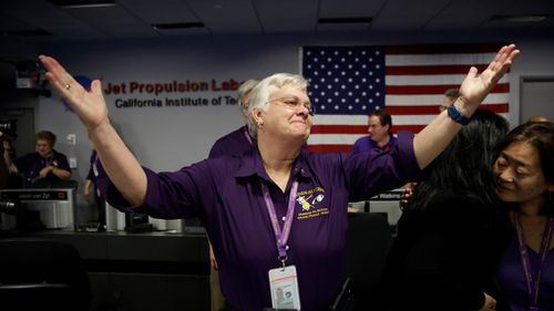 Flight director Julie Webster reacts in mission control at NASA's Jet Propulsion Laboratory after confirmation of Cassini's demise on September 15, 2017. (AP)